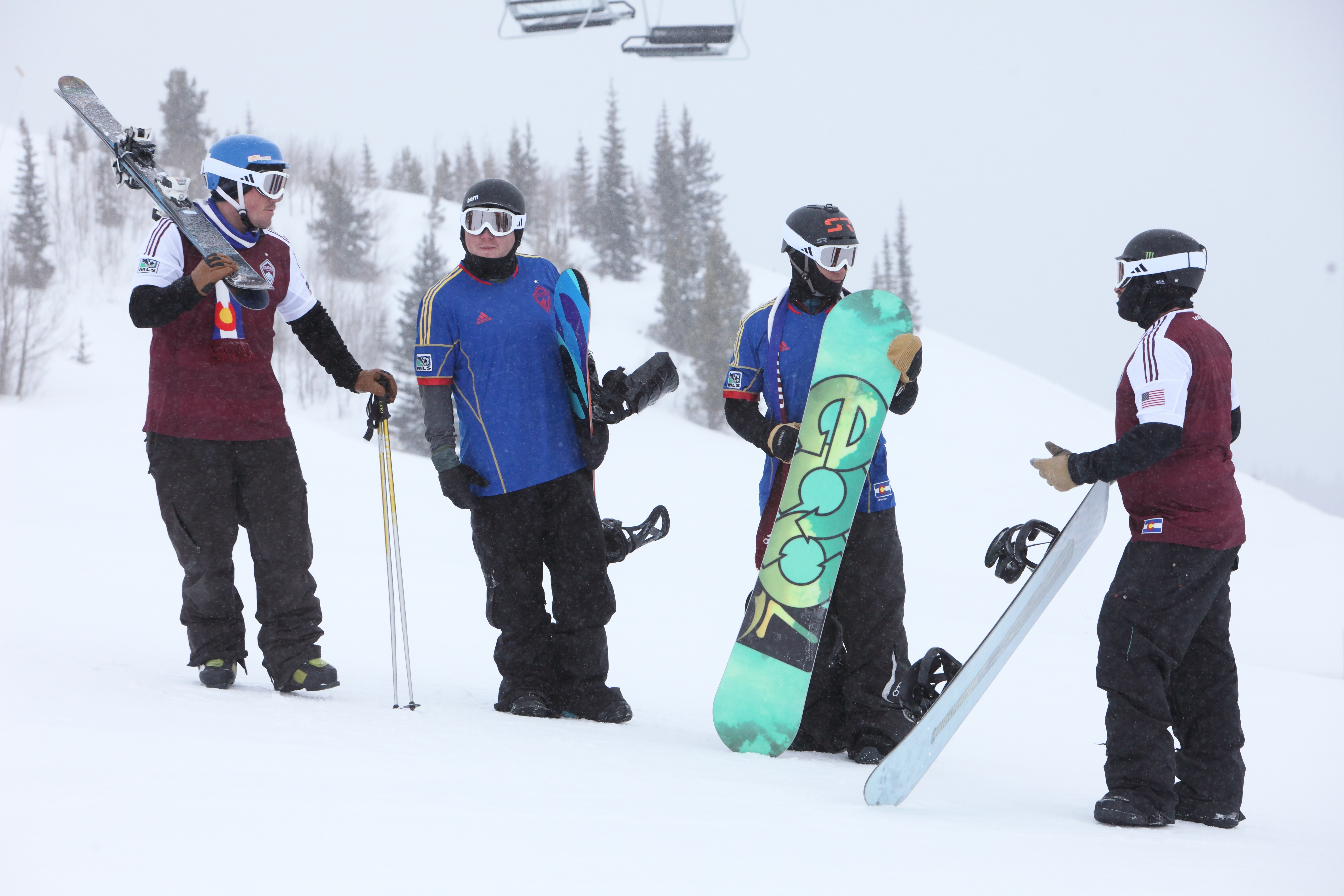 Snowboarders wearing Rapids jerseys