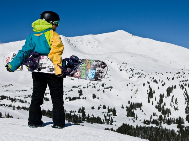 Snowboarder looking at contest bowl