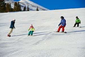 Family skiing in Breck