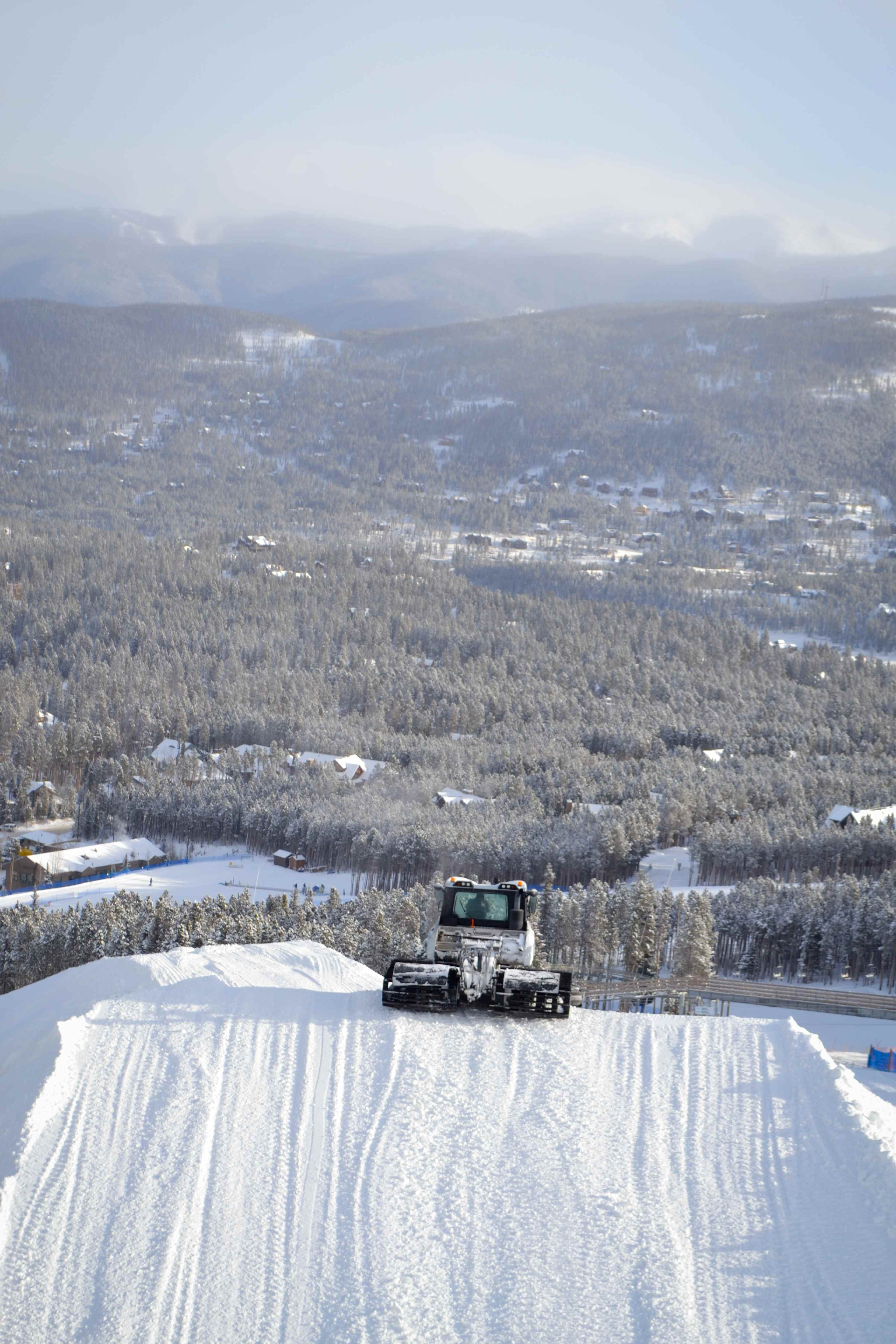 Snow cat working on the Dew Tour jumps