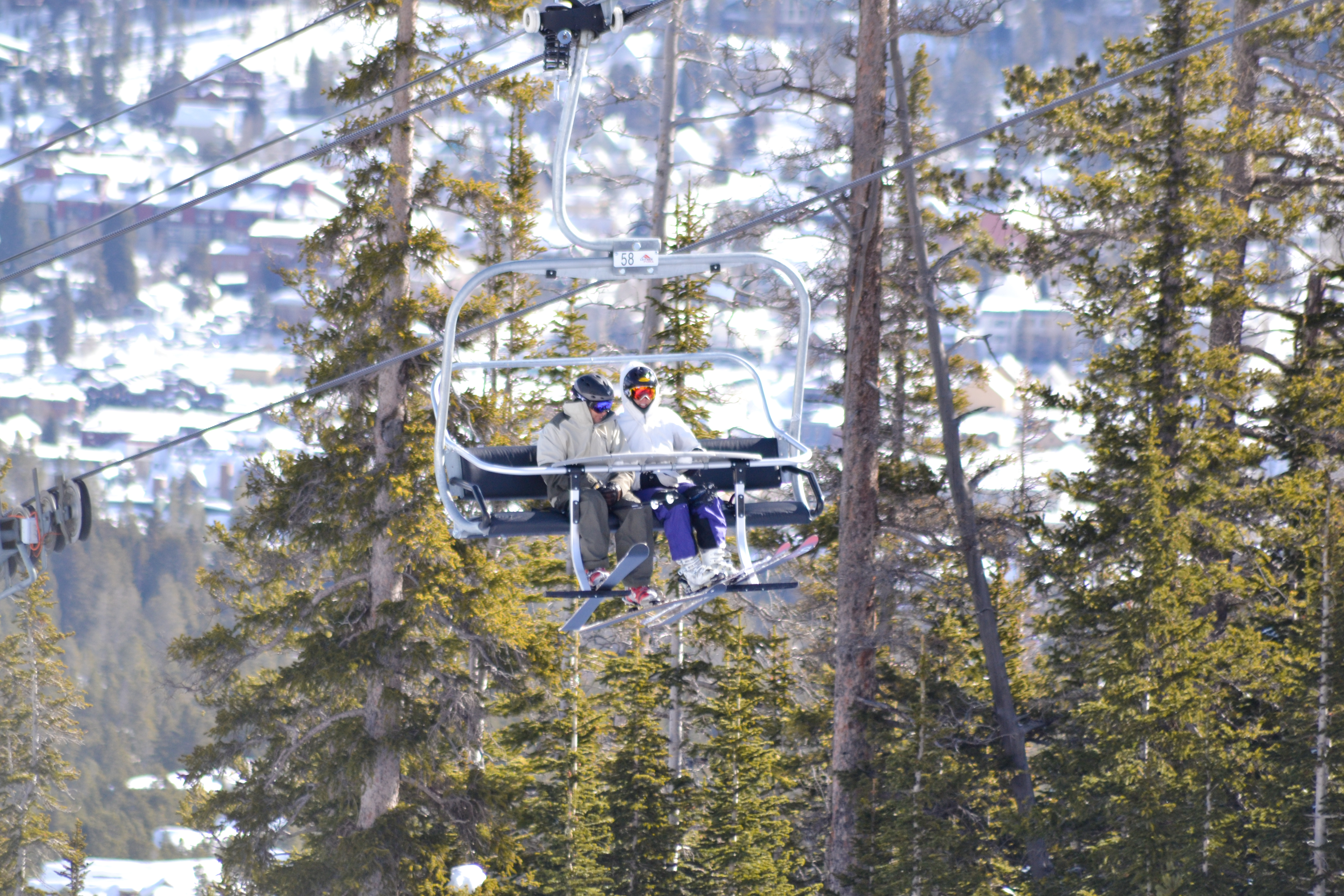 An anonymous pair studies the trail map on the lift ride up