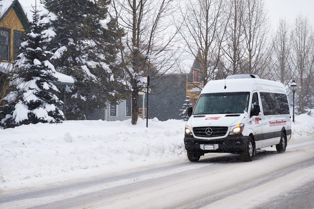 Colorado Mountain Express vehicles in inclement weather.